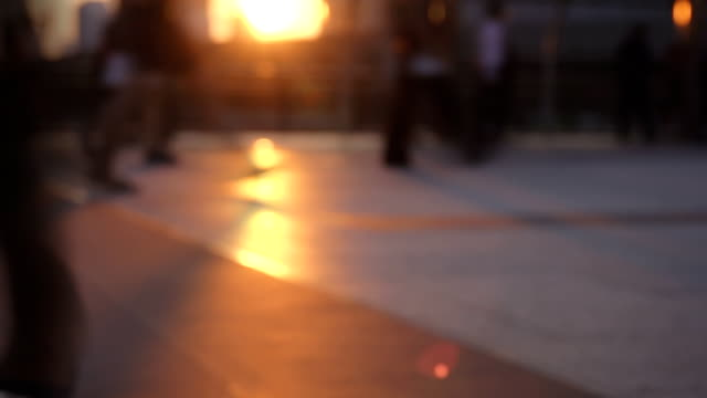 hd slow motion: silhouettes of pedestrians commuting in city. - population explosion stock videos & royalty-free footage