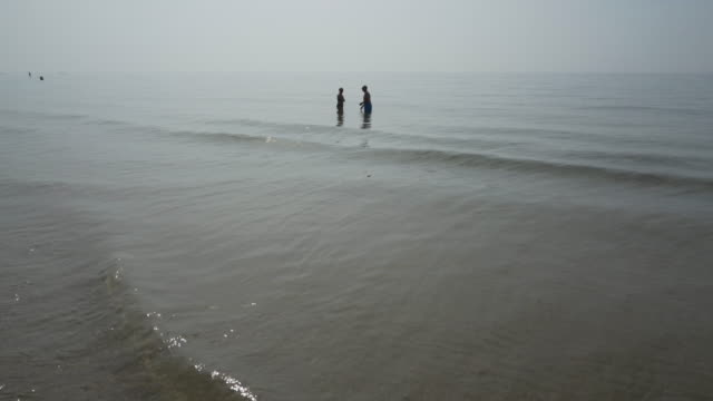 silhouettes of people in the sea - bournemouth england stock videos & royalty-free footage