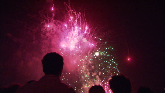 MS TU Silhouettes of people looking at fireworks, Sydney, New South Wales, Australia