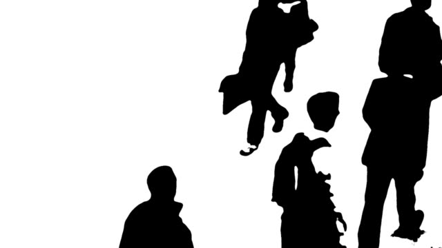 B/W Silhouettes Of People On The Move