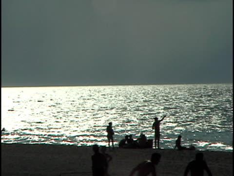 ms, silhouettes of people on varadero beach at dusk, havana, cuba - varadero beach stock videos and b-roll footage