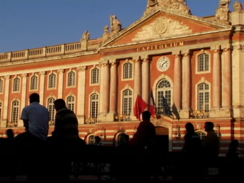 ms, silhouettes of people sitting in front of capitole de toulouse, toulouse, france - toulouse stock videos & royalty-free footage