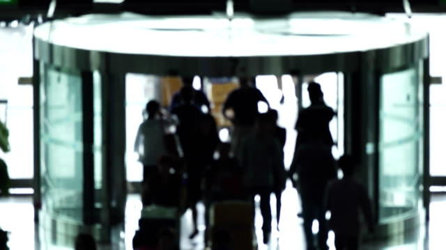 silhouettes of people walking in the airport at doorway. - doorway stock videos & royalty-free footage