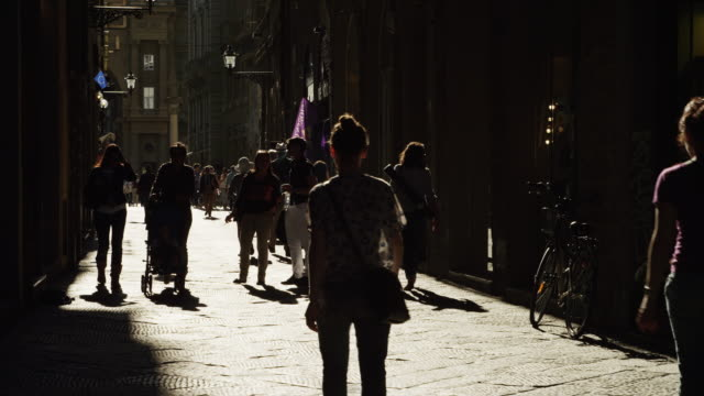 WS Silhouettes of people walking on street / Florence,Tuscany