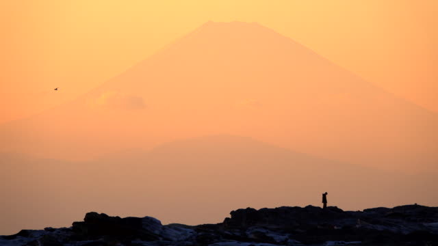 silhouettes of people with mt. fuji in dusk - exploration stock videos & royalty-free footage