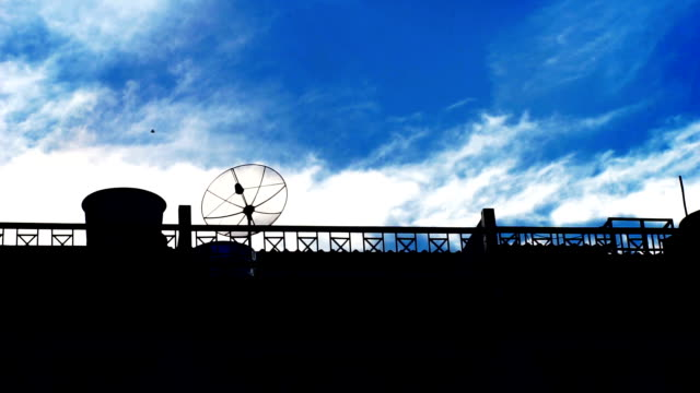 silhouettes of the roof building with beautiful view of blue sky summer day. - terrazza in legno video stock e b–roll