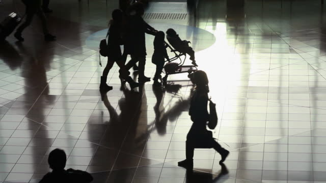 silhouettes of travelers - push cart stock videos & royalty-free footage