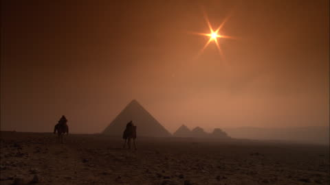 ws, silhouettes of two people riding camels at sunset, giza pyramids in background, giza plateau / giza, egypt - egypt stock videos & royalty-free footage