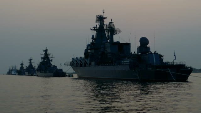 silhouettes of warships of the fleet in the evening sea - russian culture stock videos & royalty-free footage