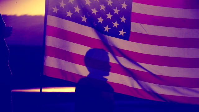 silhouettes with a US flag
