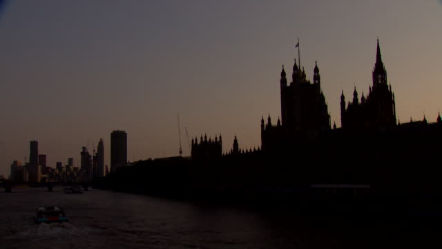 silhoutte houses of parliament at dusk - politics stock videos & royalty-free footage