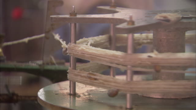 silk threads wrap around a rack in a factory. - textile mill stock videos & royalty-free footage