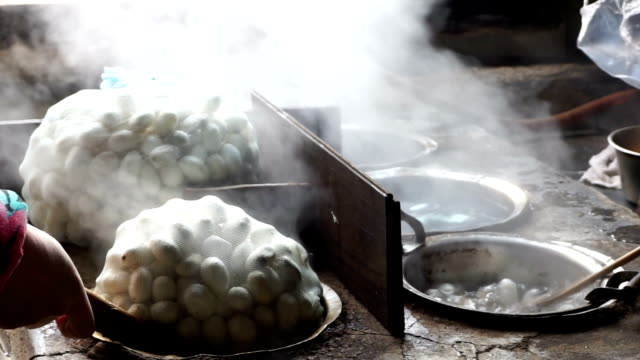 silkworm cocoon boiling in hot water