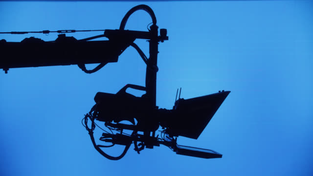 sillouette jimmy jib on film set or tv studio - dolly shot stock videos & royalty-free footage