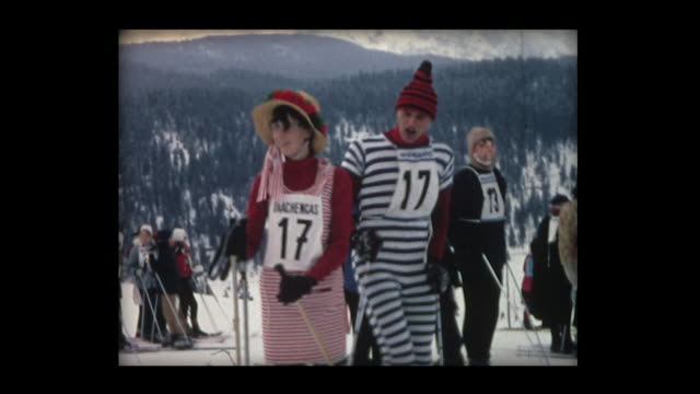 1968 silly skiers in costumes and antics - ski clothing stock videos and b-roll footage