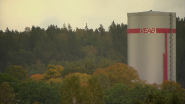 ms silo in woods, part of veab biomass combined heat and power plant / vaxjo, sweden - vaxjo stock videos & royalty-free footage