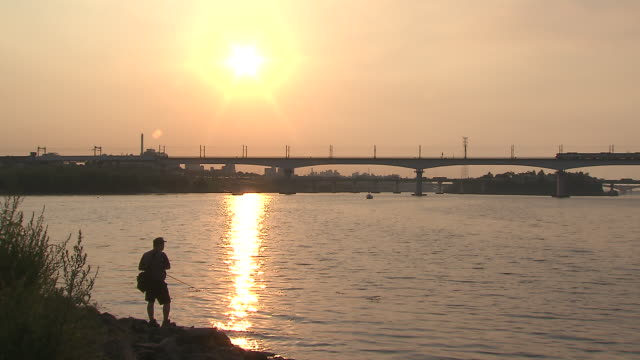 Silouetted fishing man in Han River