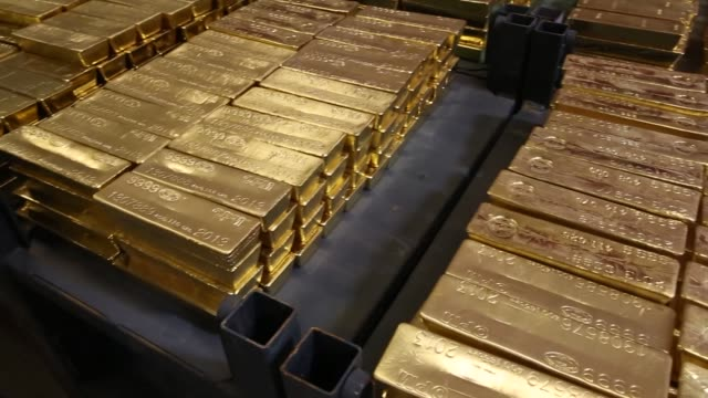 us silver and gold coin manufacturing us mint gold bars us mint silver gold coin production on june 06 2013 in west point ny - money press stock videos & royalty-free footage