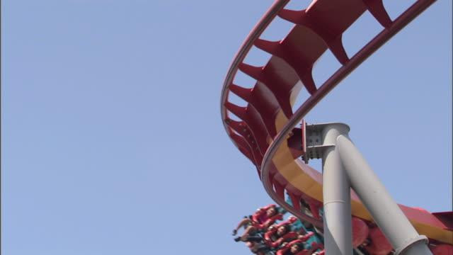 Silver Bullet roller coaster at Knott's Berry Farm theme park, car passes through frame