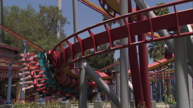 silver bullet roller coaster at knott's berry farm theme park, car passes through frame - roller coaster stock videos & royalty-free footage