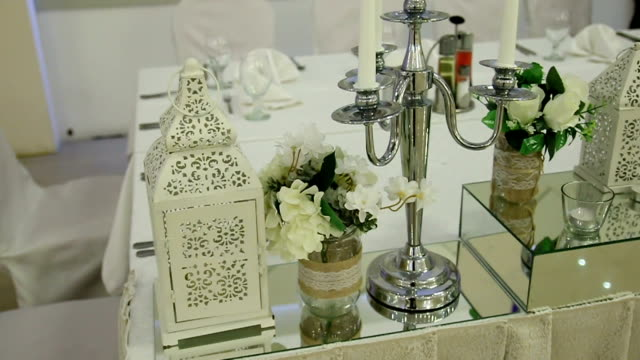 silver candlestick and other elements of wedding table - silver platter stock videos and b-roll footage