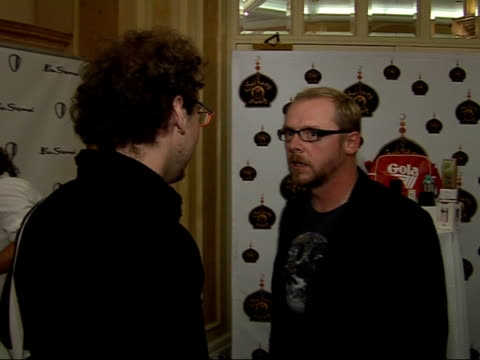 Silver Clef awards in London Simon Pegg speaking to unidentified man / More of Brand / Jeremy Clarkson along