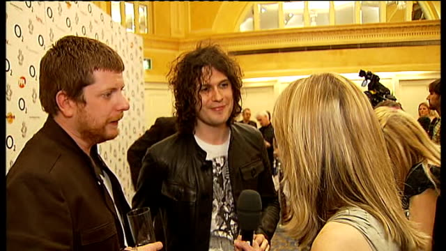 silver clef awards in london the fratellis interview sot on winning award for best british band russell brand interview sot says 'london tonight'... - russell brand stock videos and b-roll footage