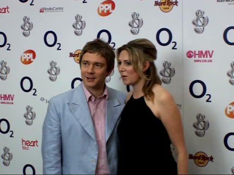 vídeos y material grabado en eventos de stock de silver clef awards luncheon 2007 martin freeman with unidentified woman posing for photocall / kate thornton posing for photocall - martin freeman