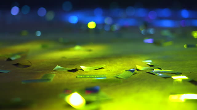 silver confetti on floor with bokeh lights in bar - flooring stock videos & royalty-free footage