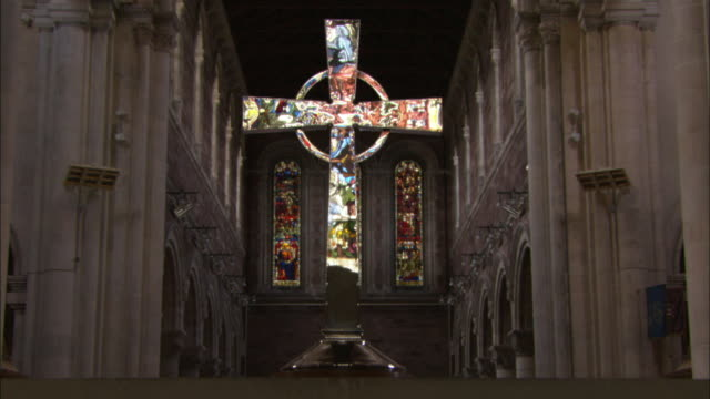 silver cross reflects stained glass windows in cathedral, belfast, northern ireland - northern ireland stock videos & royalty-free footage