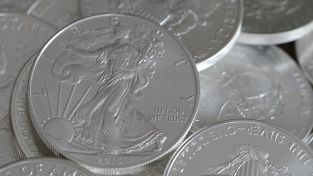 silver eagle coins - 4k - silver metal stock videos & royalty-free footage