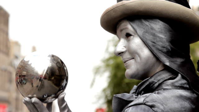 silver lady with reflective globe - street performer stock videos and b-roll footage