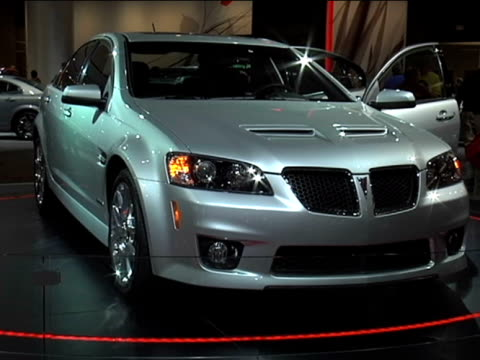 ws silver pontiac g8 gxp revolving on turntablefootage is 43 anamorphic it will play back at 853x480 2009 pontiac g8 gxp at cobo hall on january 23... - anamorphic stock videos and b-roll footage