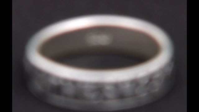lib silver ring engraved with biblical chapter and verse which promotes chastity - biblical event stock videos & royalty-free footage
