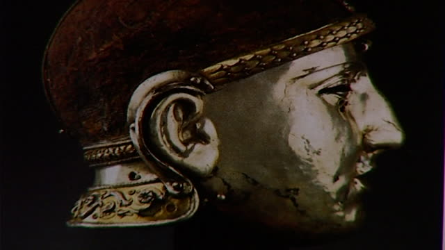 silver warrior cu on silver sculpture of head of warrior in profile - profile stock videos & royalty-free footage