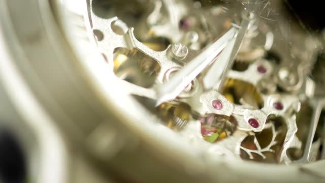 silver watch mechanism working - orologio video stock e b–roll
