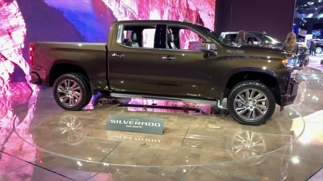 shot silverado passenger side profile / closeup front end / cu high country emblem on front grille dolly out ws front end / ws front seats dashboard... - chevrolet stock videos & royalty-free footage