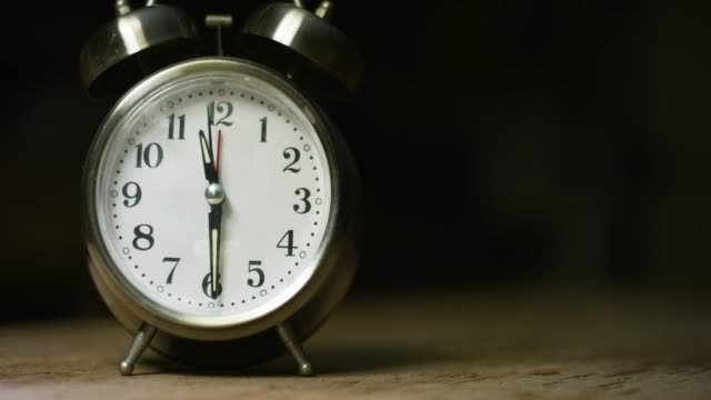 a silver-colored, metal, retro-style, analog alarm clock at 11:30 - timer stock videos & royalty-free footage