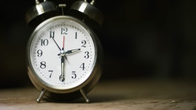 A Silver-Colored, Metal, Retro-Style, Analog Alarm Clock at 2:30