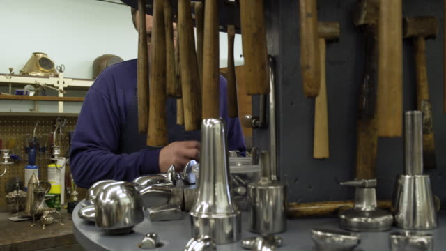 silversmith choosing between tools in a workshop - only mature men stock videos & royalty-free footage