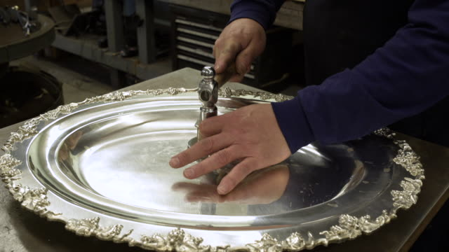 silversmith working on a salver - 盆点の映像素材/bロール