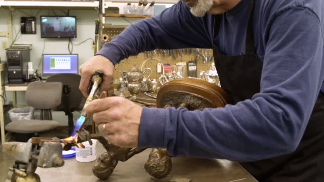 silversmith working on a sculpture - only mature men stock videos & royalty-free footage