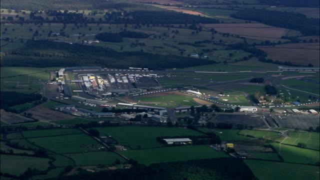 silverstone  - aerial view - england, buckinghamshire, aylesbury vale, united kingdom - railway track stock videos & royalty-free footage