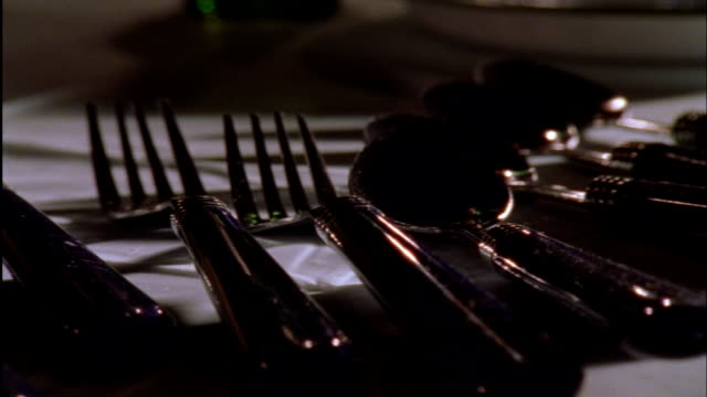 silverware shakes on a white table. - cutlery stock videos & royalty-free footage