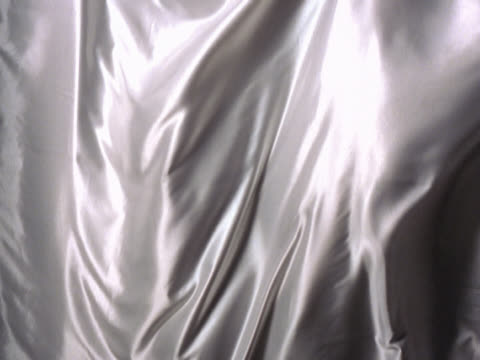 silvery fabric waving - mpeg videoformat stock-videos und b-roll-filmmaterial