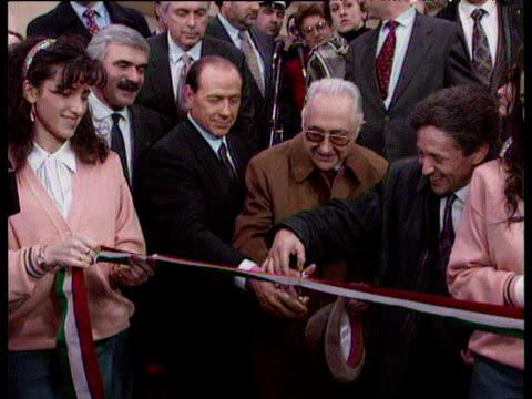 vídeos de stock, filmes e b-roll de silvio berlusconi cutting ribbon as he opens new business before he became italian prime minister rome 21 jan 94 - cortando fita