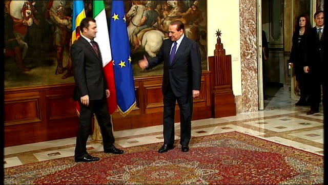 more accusations T21111009 ITALY Rome Palazzo Chigi Berlusconi shaking hands with Vlad Filat and posing for photocall Berlusconi shaking hands with...