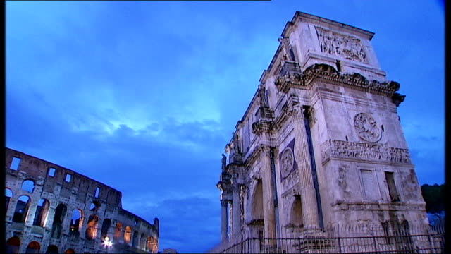 silvio berlusconi sex scandal: more accusations; t21111009 rome: ext **opera music overlaid sot** general views of colosseum and arch of titus police... - 不祥事点の映像素材/bロール