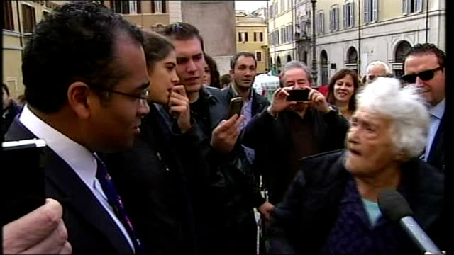 silvio berlusconi to step down as prime minister italy rome ext annarella protesting outside parliament sot italian mp sergio de gregorio trying to... - krishnan guru murthy stock videos & royalty-free footage