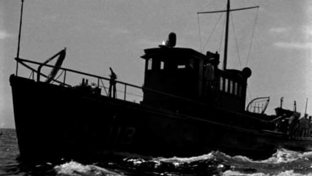 nx - similar to:  at end scene cutter comes close to camera - cutter then drops back and at end scene passes l f.g. - coast guard cutters - b&w. - 1935 stock videos & royalty-free footage